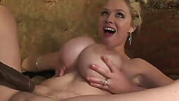 Busty blonde MILF without bra swims between two hefty black cocks