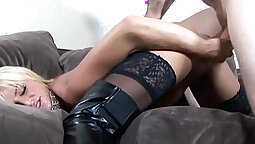 Busty blonde rides the dick while wearing black satin stockings