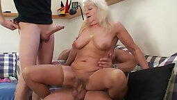 Blonde is getting both her holes filled up with cum in 3some party