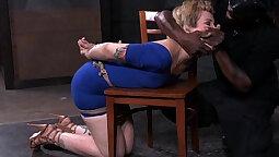 Busty chicks use bondage device to fuck