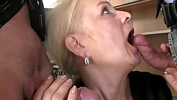 Hunky mature Seductively swallows a stiff cock