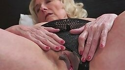 Granny stroking a black dick
