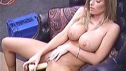 Blond bombshell Nikki fucking herself with a small Vibrator