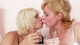 Blonde milf licking and toying her twat with a dildo
